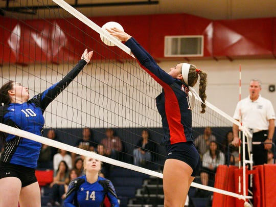 Kennedy's Sophia Carley (11) sends the ball back to St. Paul's Haley Scott (10) in a volleyball match on Thursday, Oct. 5, 2017, at Kennedy High School in Mt. Angel.