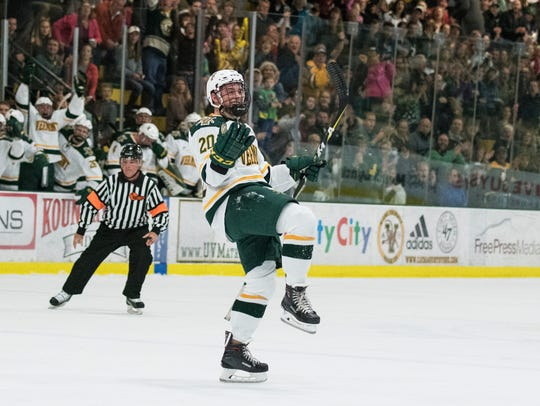 Vermont forward Ross Colton (20) celebrates after scoring