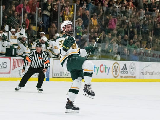 Vermont forward Ross Colton (20) celebrates after scoring a goal during the men's hockey game between the Colorado College Tigers and the Vermont Catamounts at Gutterson Field House on Friday night October 6, 2017 in Burlington.
