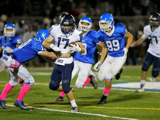 Mater Dei's Kyle Devaney runs the ball as Shore Regional's Tom Bocco attempts a tackle during the second half of the Mater Dei Prep and Shore Regional football game at Shore Regional High School in West Long Branch, NJ Friday, October 6, 2017.