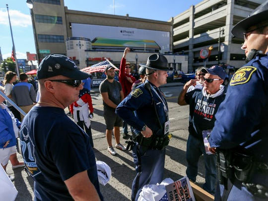 Michigan State Police talk with protesters against