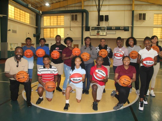 The Live Like Cole Foundation recently presented checks and gifts to several local youth groups, including 14 Wilson basketballs, a bag and equipment pump to the Gifford Youth Achievement Center for its students in Indian River County. Showing off the new basketballs are, front row, from left, Freddie Woolfork, director of public relations and facilities operations at GYAC, Joshua Talley, A'mayah Rogers, Ty Stinson, Courtlyn Dix and Joenisha Eristhene. Back row: Kyree Brown, Cameron Henry, Tamisha Collier, Tyler Davis, Alicia Mneiro, Kyle Green, Tatiana Wallace, Ah'lea Bell and Jacqueline Bell.
