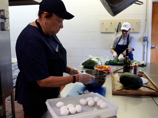 From left, La Verne Norfleet and volunteer Denise Walsh prepare lunch for students using fresh ingredients as part of Ascension's new lunch program. The school recently changed its lunch program to include fresh local chicken, turkey and produce while providing approximately 80 meals a day for students, which costs $4.00 and includes a salad bar. Oct. 2, 2017