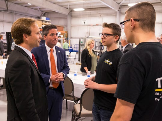 Lt. Gov. Brian Calley, left, and Port Huron City Manager James Freed, left of center, speak with Port Huron freshman Matthew Herber, right of center, and Northern sophomore Connor Jawor after a Q&A at Triton Automation Group in Port Huron Oct. 10. Matthew and Connor are both students employed by Triton.