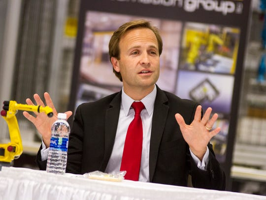 Michigan Lt. Gov. Brian Calley attends a Q&A at Triton Automation Group in Port Huron Oct. 10.
