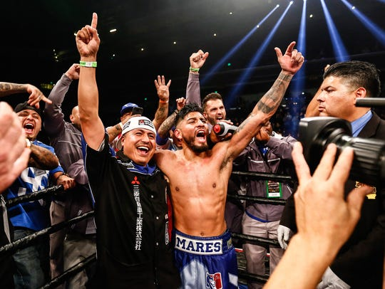 Abner Mares celebrates with his team after his win