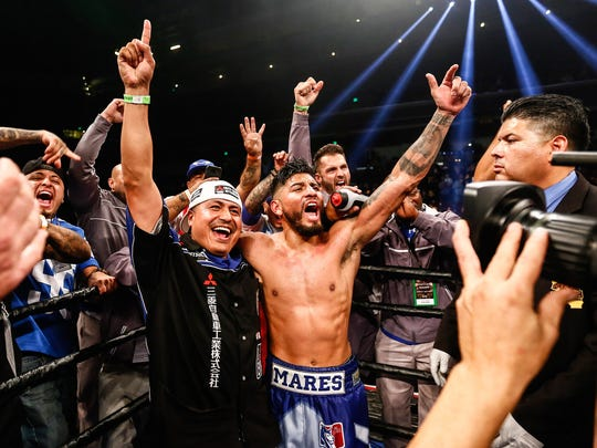 Abner Mares celebrates with his team after his win over Jesus Cuellar on Dec. 11, 2016.