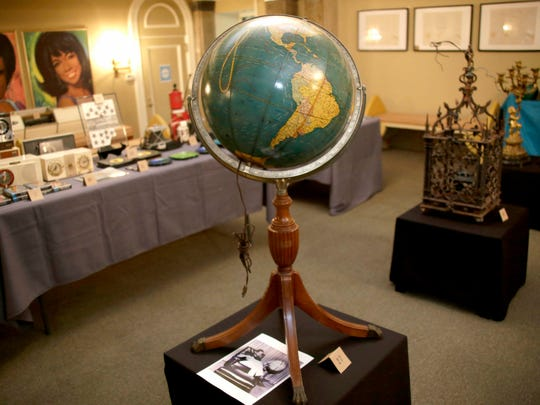 A globe once belonging to Berry Gordy will be up for auction at his former home in the Boston Edison neighborhood of Detroit. It is photographed on Oct. 11, 2017.