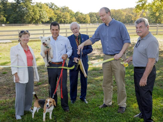 "From left: Somerset County Park Commissioner Helen ""Chickie"" Haines, Freeholder Mark Caliguire, Park Commission Vice President Bill Crosby, Montgomery Mayor Ed Trazska, and Park Commission Director Ray Brown officially open the Dog Park at Skillman Park in the Skillman section of Montgomery."