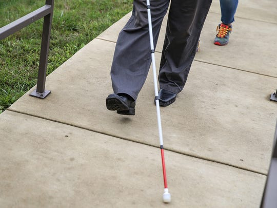 Leo Leighton walks the Bosma Enterprises orientation and mobility trail during a white cane lesson in Indianapolis, Tuesday, Oct. 10, 2017. Bianca Gerena is his orientation and mobility specialist at Bosma Enterprises. Leighton, who has partial vision loss due to ocular histoplasmosis syndrome, is learning to navigate with a white cane. In 1964, President Lyndon B. Johnson declared October 15 national White Cane Safety Day.