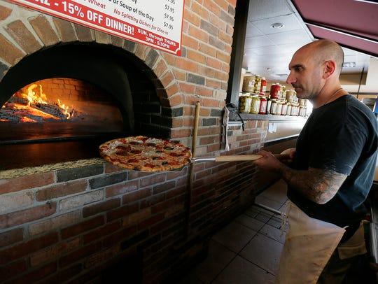 Marco Ingrao of Jackson prepares a pizza at Mamma Mia