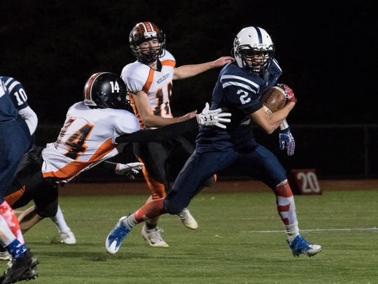 Burlington's Kevin Garrison (2) runs with the ball