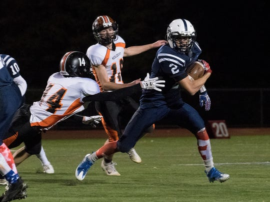 Burlington's Kevin Garrison (2) runs with the ball during the high school football game between the Middlebury Tigers and the Burlington Seahorses at Buck Hard field on Friday night.