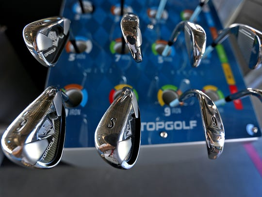 Golf clubs are ready for use on opening day of TOPGOLF in Fishers, Friday, Oct. 13, 2017.