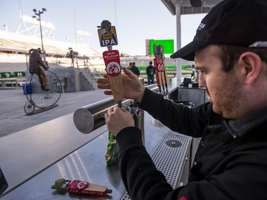 Spectra beer pourer Ryan Kepler attaches the beer tap