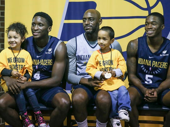 From left, Aryelle Shumpert, 5, Indiana Pacers guard