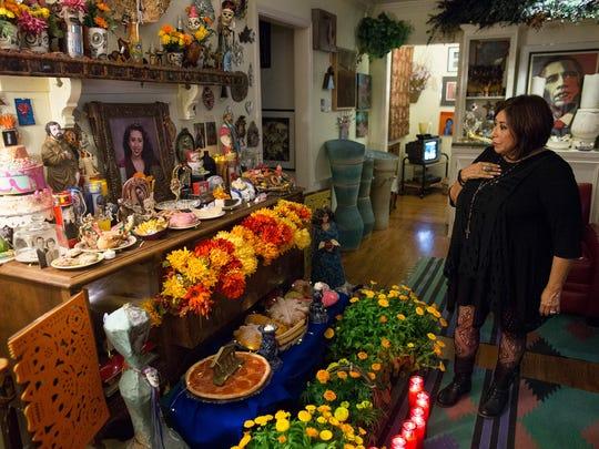 Jacqueline Rosier looks over the Dia de los Muertos altar in her home honoring her daughter Jessica Gonzalez, Thursday, Oct. 29, 2015.