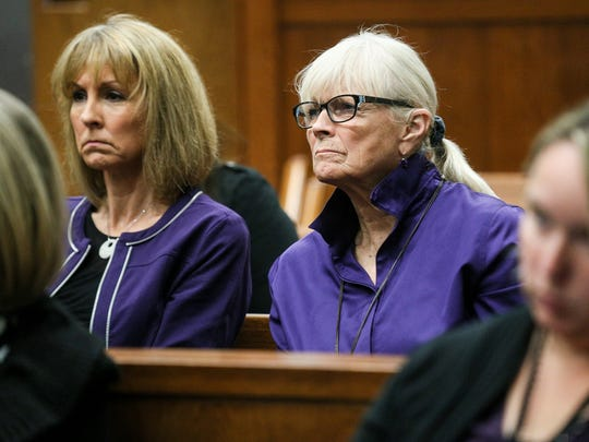 Nicole Beverly's sister Christine Bernauer, 54, of Ypsilanti and her mother Sally Szilagyi, 74, of Saline attend the hearing against her ex-husband wearing purple for awareness for domestic violence at the Washtenaw County District court in Ann Arbor, Mich. on Thursday, Oct. 19, 2017.