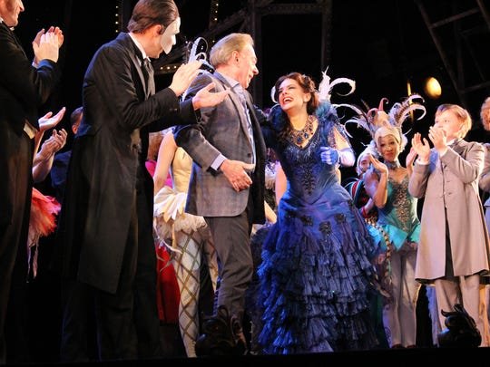 "Andrew Lloyd Webber (center, in gray jacket) at a curtain call for ""Love Never Dies"" at the Fisher Theatre."