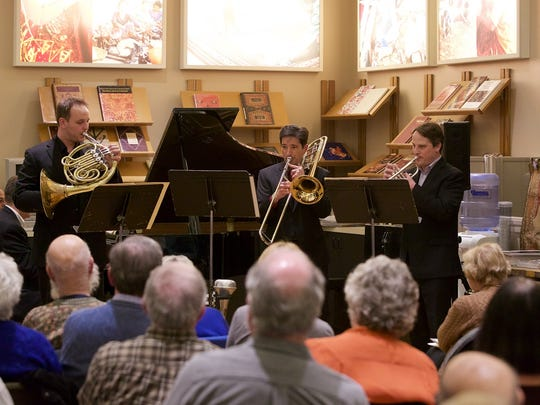A brass trio plays during a Detroit Chamber Winds & Strings performance in February at Hagopian World of Rugs in Birmingham. From left are Scott Strong, Garth Simmons and Robert White.