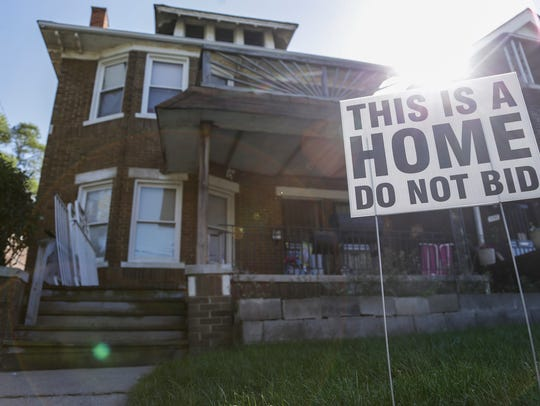A sign is seen outside of Denise Tanks' house in Detroit,