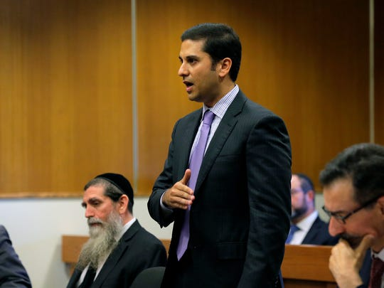 Lee Vartan, lawyer of Lakewood Rabbi Osher Eisemann, formerly head of SCHI school and charged with stealing $630,000 in public tuition funds, delivers his arguments during Eisemann's hearing before Judge Benjamin Bucca at Middlesex County Courthouse in New Brunswick, NJ Friday, October 20, 2017.