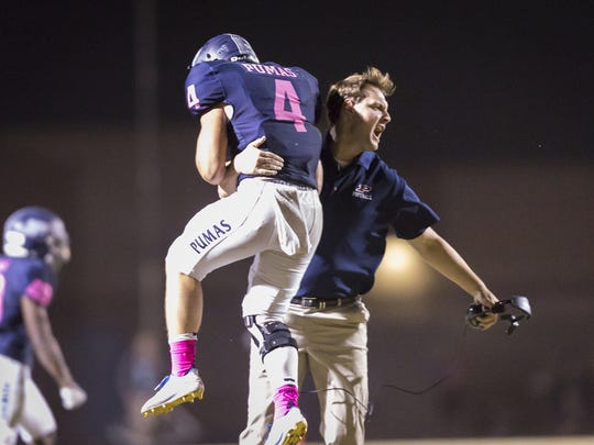 Inside linebacker Cutter Hatch (4) of the Perry Pumas celebrates in the second half of the high school football game between the Perry Pumas and the Hamilton Huskies at Perry High School on Friday, October 20, 2017 in Gilbert, Arizona.