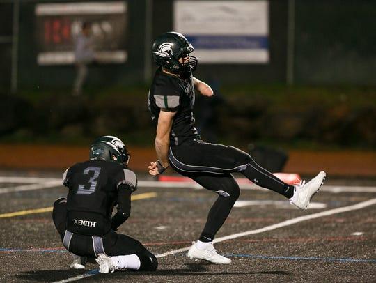 West Salem's Alex Hurlburt kicks a PAT against South