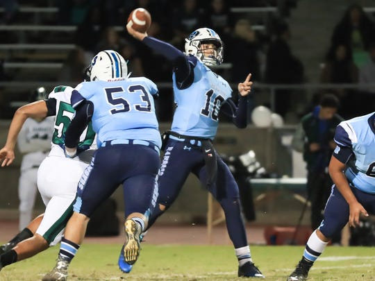 Redwood's QB Hector Gonzalez (10) passes under pressure from El Diamante in a West Yosemite League high school football game at Mineral King Bowl on Oct 20th, 2017