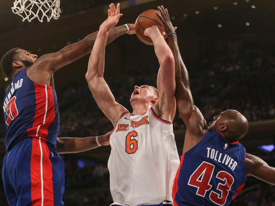 New York Knicks forward Kristaps Porzingis (6) battles Detroit Pistons center Andre Drummond (0) and forward Anthony Tolliver (43) for a rebound in the fourth quarter of the Pistons 111-107 victory at Madison Square Garden.