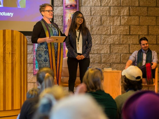 Senior Minister Rev. Gretchen Haley, left, introduces Peruvian sanctuary seeker Ingrid Encalada Latorre to congregants, Sunday morning, Oct. 22, 2017, during a worship service at Foothills Unitarian Church in Fort Collins, Colo.