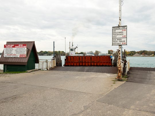 Champion's Auto Ferry pulls up to the dock in Clay Township to unload vehicles from Harsens Island Thursday, Oct. 23. State Rep. Dan Lauwers introduced a bill updating oversight of the Carriers by Water Act, which would make it easier for the ferry to adjust its rates.