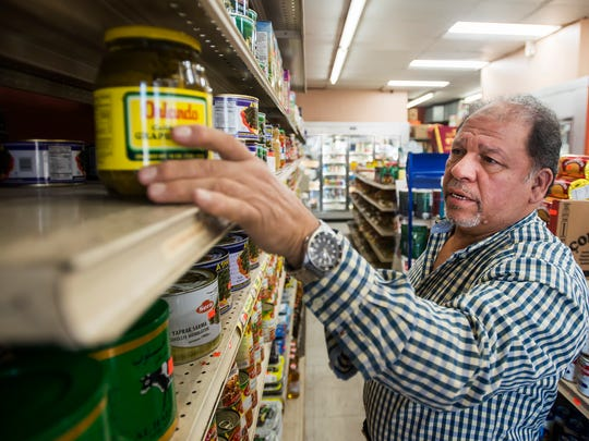 Shop owner Taher Misurati shows some of his store's popular items, Friday, Oct. 20, 2017, at the Olive Tree Market on South College Avenue in Fort Collins, Colo.