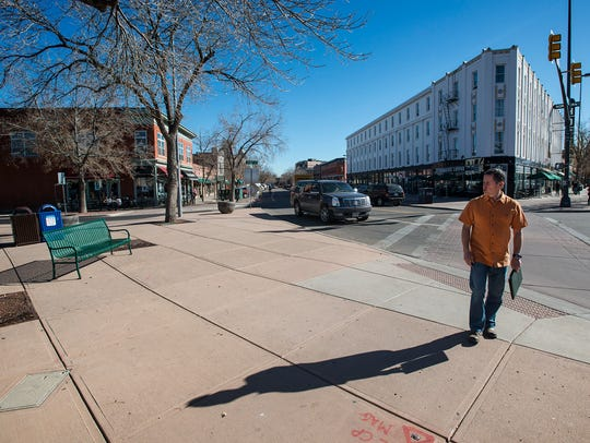 Todd Dangerfield shows one of the micro-spaces the city hopes to beautify,  Wednesday, Oct. 25, 2017, on the pork chop island at the intersection on North College Avenue, Pine and Walnut streets. Dangerfield is project manager for the Fort Collins Downtown Development Authority, which is working with The Urban Lab to beautify micro-spaces and increase their use.