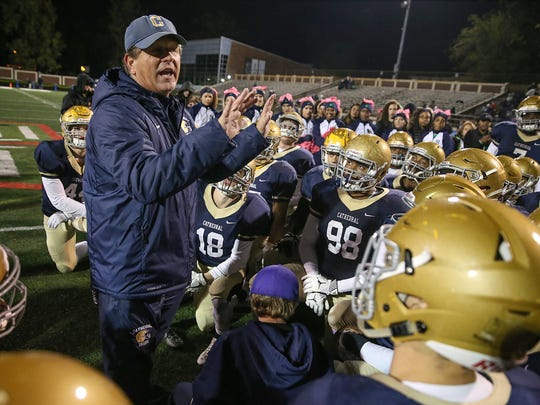 Cathedral Fighting Irish head coach Rick Streiff talks to his team after they after defeated the Roncalli Rebels, 28-23, in IHSAA sectionals at Arsenal Technical High School, Indianapolis, Friday, Oct. 27, 2017.