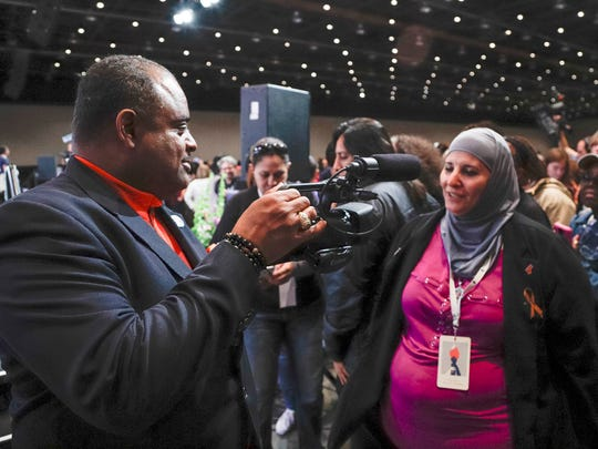Roland Martin, left, interviews Samia Assed of Albuquerque,