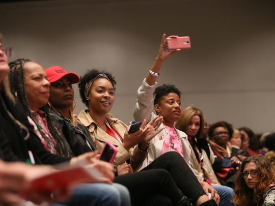 People from the audience Facebook Live, live stream, and video the closing ceremony during the Women's Convention at the Cobo Center in Detroit on Sunday, Oct. 29, 2017.