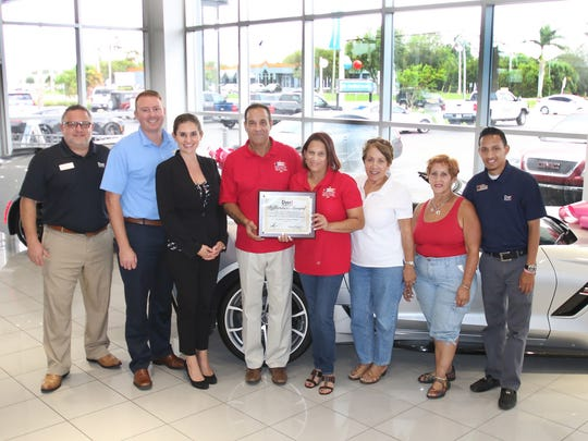The October Dyer Difference Award for St. Lucie County recognizes the Treasure Coast Puerto Rican Day Parade organization, which will host the Dec. 9 Puerto Rican Day Parade and a full day of free, family fun and festivities. Pictured are, from left, Jonathan Holmes, Will and Tatiana Dyer, Raul and Mayra Irizarry, Mildred and Lucy Irizarry, and Christian Jiminez.