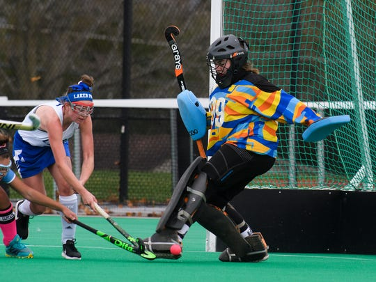 Colchester goalie Ceria Morse (99) makes a save during the girls semi final field hockey game between the Colchester Lakers and the South Burlington Wolves at Moulton Winder field at UVM on Tuesday afternoon October 31, 2017 in Burlington.