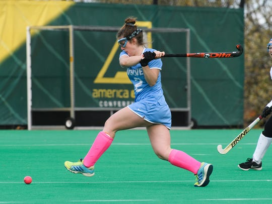 South Burlington's Kate Hall (2) takes a shot during