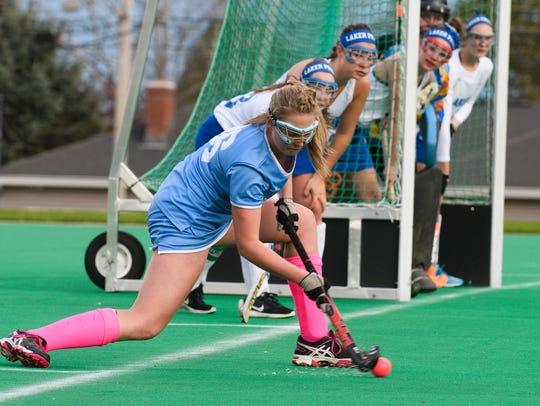 South Burlington's Grace Hoehl (16) takes a corner