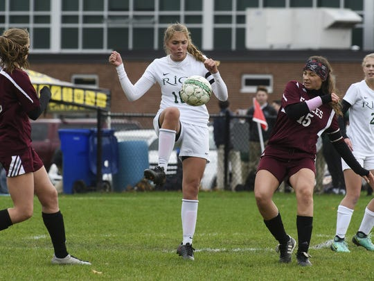 Rice's Abby McKeown (18) plays the ball between Mt.