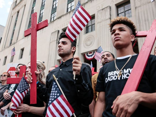 Allen Brooks, 16, of Sterling Heights, far right, and