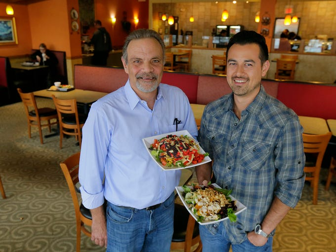 Owners Steve Umbrell and Nathan Sensenig hold the Fire