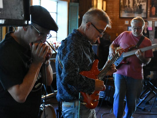 Paul Fardella, right, plays bass with the Flim Flam Kings, along with Ben Baker on guitar and David Friedman on harmonica.