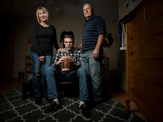 Fort Collins High School sophomore quarterback Hayden Iverson poses with his grandparents Denise and Loren in his bedroom, Wednesday, Nov. 1, 2017 at his home in Fort Collins, Colo.