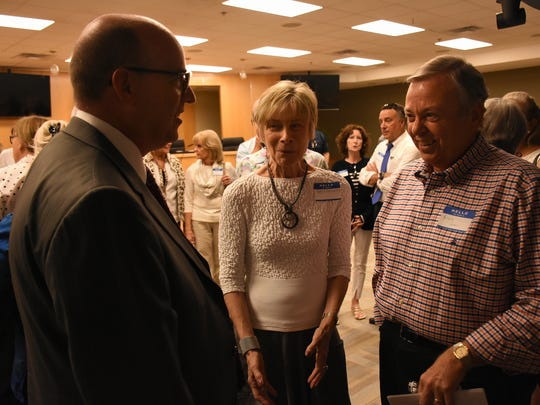 "Candidate David Fraser, left, speaks with Carole Roberts and Bruce Graev. The City of Marco Island hosted a ""Meet the City Manager Candidates"" event Wednesday evening in the city council chambers."