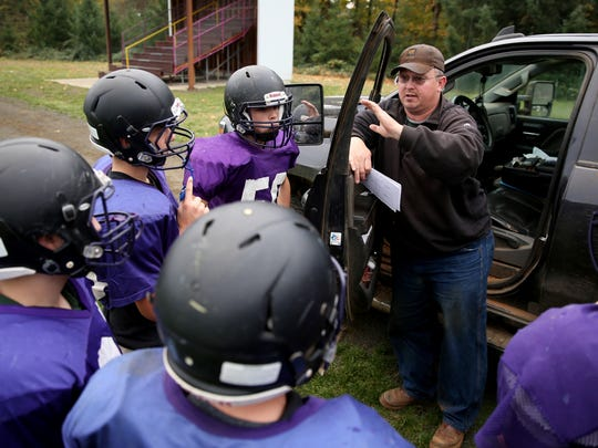 Laric Cook coaches his team during a football practice at Falls City High School in Falls City, Ore., on Wednesday, Nov. 1, 2017.
