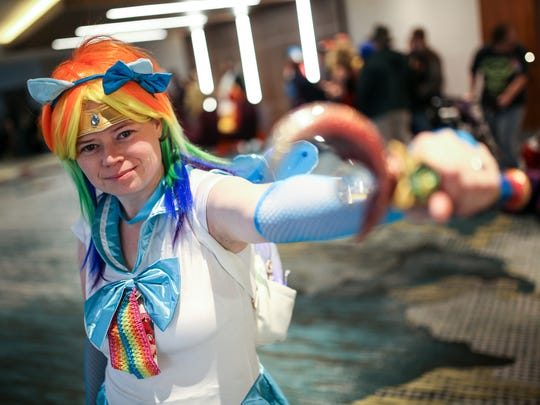 Amy Meabon, 35, of White Lake is dressed up as a mash-up of anime Sailor Moon and Rainbow Dash from My Little Pony during Youmacon 2017 at the Renaissance Center in Detroit on Friday, Nov. 3, 2017.