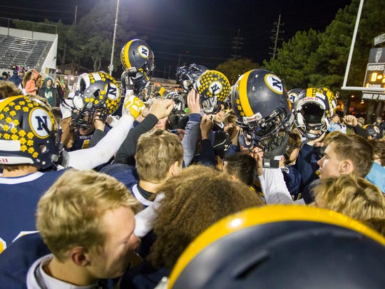 The Port Huron Northern High School Huskies huddle after falling 50-0 to Warren De La Salle High School in the MHSAA division championship football game at Memorial Stadium Nov. 3.